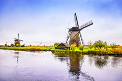 Windmills and canal in Kinderdijk, Holland or Netherlands. Unesc Stock Image