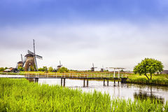 Windmills and canal in Kinderdijk, Holland or Netherlands. Unesc Royalty Free Stock Image