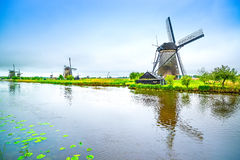 Windmills and canal in Kinderdijk, Holland or Netherlands. Unesco site Royalty Free Stock Images
