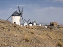 Windmills with castle, Consuegra, Castile-La Mancha, Spain. Consuegra is famous due to its windmills. They became famous in the 16th century, when Don Quixote Stock Image