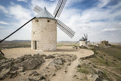 Windmills and the Castle in Consuegra, province of Toledo, Castilla-La Mancha, Spain. White windmills and the Castle in Consuegra, province of Toledo, Castilla Royalty Free Stock Images