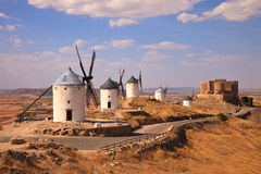 Windmills and castle of Consuegra. Spain Royalty Free Stock Images
