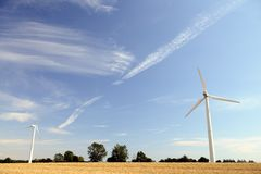 Windmills and clouds. With blue sky royalty free stock photo