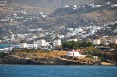 Windmills on coast of mountainous greek island mykonos, greece Royalty Free Stock Images