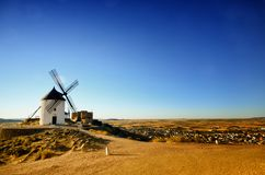 Consuegra is a litle town in the Spanish region of Castilla-La Mancha, famous due to its historical windmills, Caballero del verde Stock Images