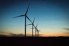 Wind turbines creating green energy in Denmark royalty free stock image