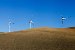 Windmills on crop field Royalty Free Stock Photos