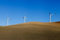 Windmills on crop field Royalty Free Stock Photos