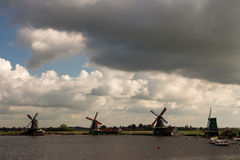 Windmills dams barriers on the North Sea peterson netherlands Stock Photo