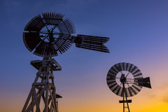 Windmills at dusk, Texas royalty free stock photo