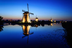 Windmills at dusk under a blue sky Royalty Free Stock Image