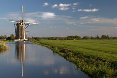 Windmills on dutch countryside Stock Photos