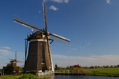 Windmills on dutch countryside Royalty Free Stock Image