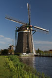 Windmills on dutch countryside Stock Photo