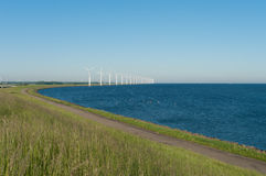 Windmills on a dutch dike Royalty Free Stock Photography