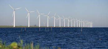 Windmills on a dutch dike Stock Photo