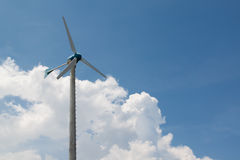 Windmills for electric generator with blue sky and white cloud Royalty Free Stock Photography