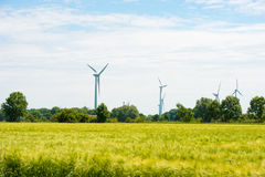 Windmills for electric power production, Hooksiel, Wangerland, Germany. Copy space for text. Royalty Free Stock Image