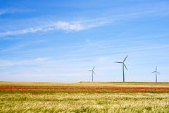 Wind energy concept. Windmills for electric power production, Huesca province, Aragon, Spain Royalty Free Stock Photo