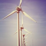 Windmills electric power. Vintage style photo Stock Photos