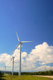 Windmills, Eolic. Eolic power generators. Beautiful sky blue and clean Stock Image