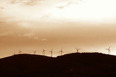 Windmills, Eolic. Eolic power generators in the sunset Royalty Free Stock Photos