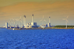 Windmills and factory in the sunset Royalty Free Stock Photography