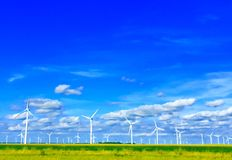 Windmills. In a farm field Royalty Free Stock Images