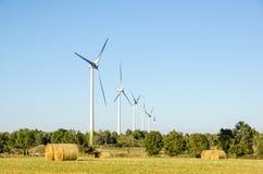 Windmills farm Stock Images