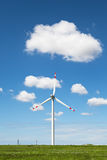 Windmills in a field Stock Photography