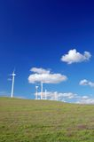 Windmills in field royalty free stock photography