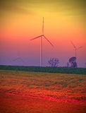 Windmills on field, abstract colors stylized Royalty Free Stock Image