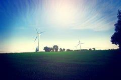 Windmills on the field. Stock Photos