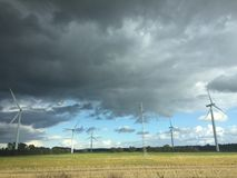 Windmills. In the field, clouds and sun Royalty Free Stock Photos