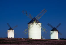 Windmills at field in night Royalty Free Stock Photo