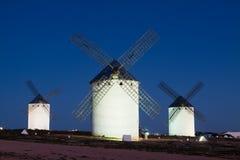 Windmills at field in night Stock Photos
