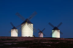 Windmills at field in night Stock Image