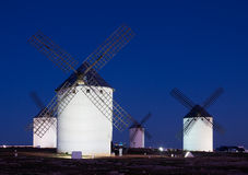Windmills at field in night Royalty Free Stock Image