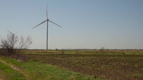 Windmills in the field on a summer day, Kherson stock footage