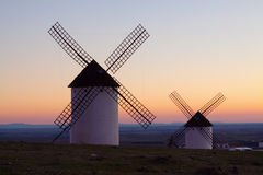 Windmills at field in sunrise Royalty Free Stock Photos