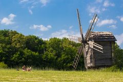 Windmills in the field under the clouds. Pirogovo, Kiev, Ukraine Stock Images