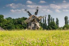 Windmills in the field under the clouds. Pirogovo, Kiev, Ukraine Stock Image