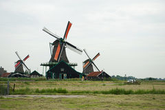 Windmills and the field at Zaanse Schans, Holland Stock Photography