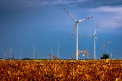 Windmills in the fields with dramatic rain clouds in the backgro. Und Royalty Free Stock Photos