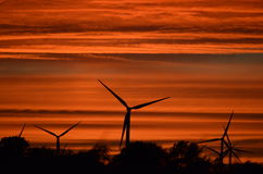 Windmills in a fiery sky Royalty Free Stock Photography