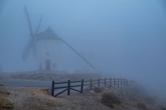 Windmills in the fog in Consuegra town in Spain Royalty Free Stock Photography