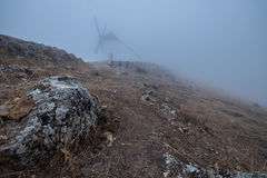 Windmills in the fog in Consuegra town in Spain Royalty Free Stock Images