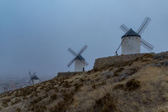 Windmills in the fog in Consuegra town in Spain Royalty Free Stock Photos
