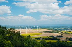 Windmills in France. Wind turbines in France. Fields with windmills. Field in bloom. Renewable energy. Protect the environment stock images