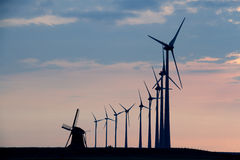 Windmills in front of sky Stock Images
